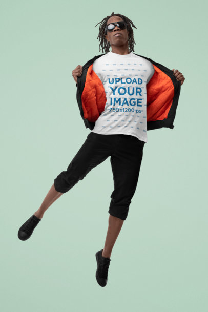 Mockup of a Man Showcasing His T-Shirt in Mid-Air M10773