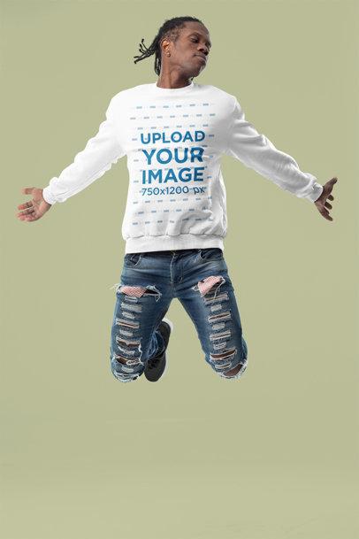 Sweatshirt Mockup of a Man Jumping in a Studio m10782