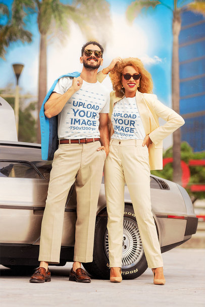 T-Shirt Mockup of a Couple with Miami Vice-Inspired Outfits by a Classical Car m12027