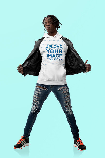 Hoodie Mockup Featuring a Confident Man Posing at a Studio m10780