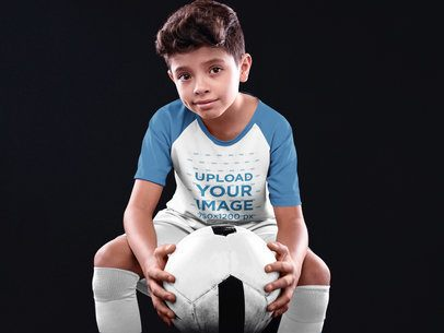 Custom Soccer Jerseys - Kid Holding the Ball While SItting Down a16597