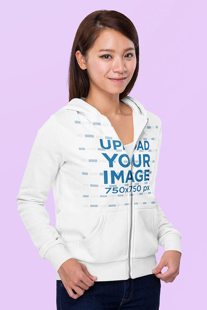 Full-Zip Hoodie Mockup Featuring a Young Woman Standing in a Studio m7315-r-el2