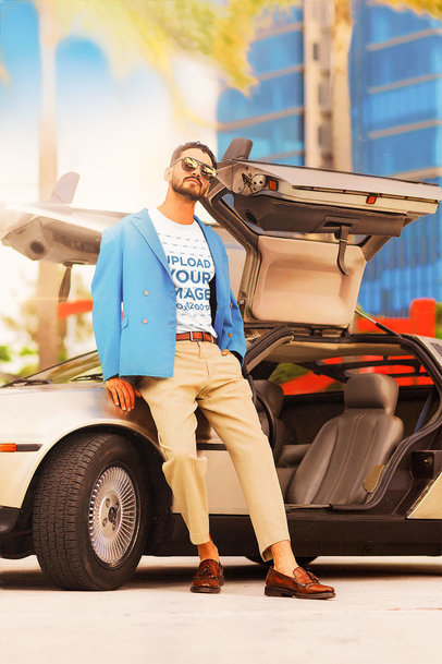 T-Shirt Mockup Featuring a Bearded Man With Sunglasses by a Retro Car m12013