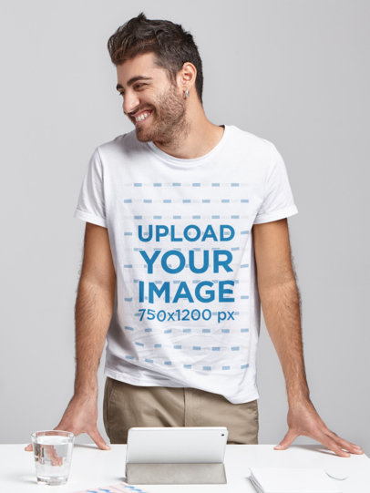 T-Shirt Mockup of a Bearded Man Standing Behind a Desk m2922-r-el2