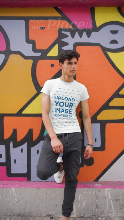 T-Shirt Video of a Man Posing in Front of a Wall with Street Art 3580v
