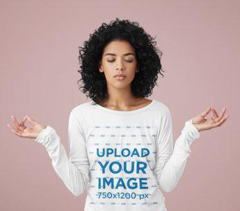 Long Sleeve Tee Mockup Featuring a Woman Meditating in a Studio m2924-r-el2
