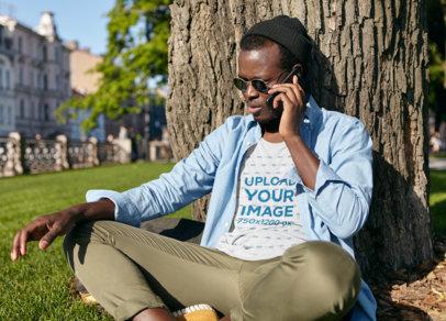 T-Shirt Mockup of a Man on the Phone at a Park m2967-r-el2