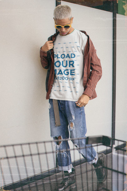 Basic T-Shirt Mockup Featuring a Young Man in a 90s Outfit m12509