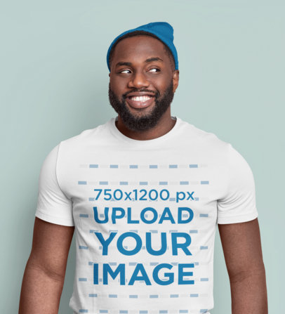 T-Shirt Mockup Featuring a Bearded Man Smiling in a Studio m3581-r-el2