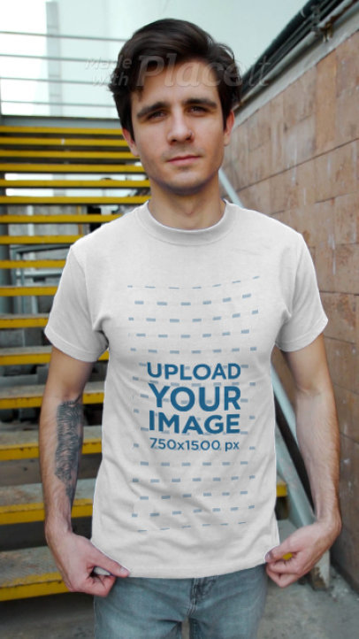 T-Shirt Video of a Tattooed Man Posing in an Urban Environment 3741v