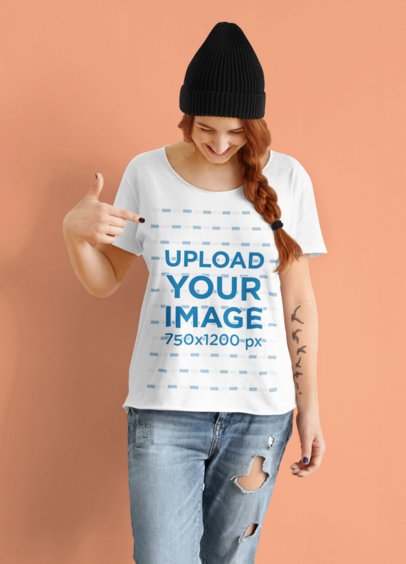 Mockup of a Tattooed Woman Pointing at Her T-Shirt in a Studio m2926-r-el2