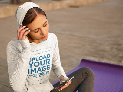 Hoodie Mockup Featuring a Young Woman Checking Her Phone m8282-r-el2