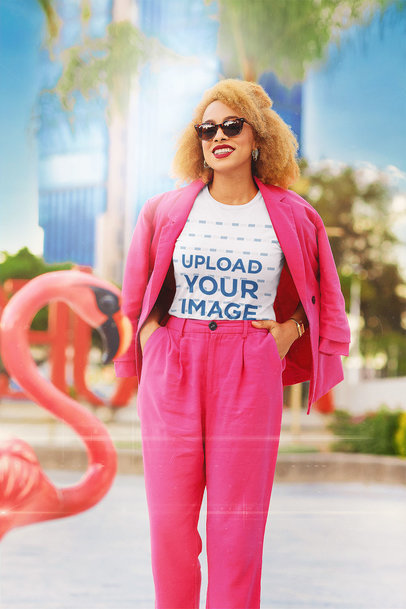 Retro-Styled T-Shirt Mockup of a Happy Woman Posing by a Flamingo Figure m12039