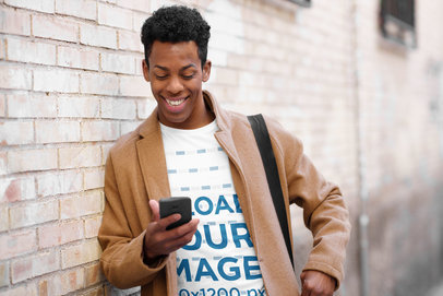 T-Shirt Mockup of a Happy Man Checking His Phone on the Street m10888-r-el2