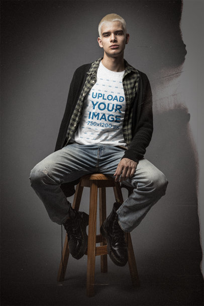 Bella Canvas T-Shirt Mockup Featuring a Serious Man Sitting on a Stool m12726