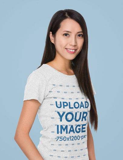 Mockup of a Long-Haired Woman Wearing a Heather Tee in a Studio m7364-r-el2
