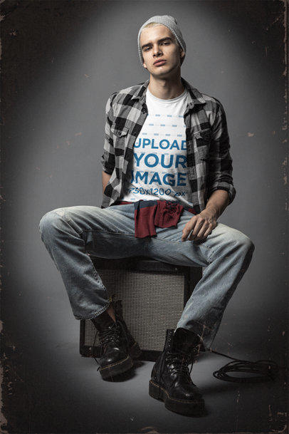 Bella Canvas T-Shirt Mockup Featuring a Man Sitting on a Guitar Amp m12723