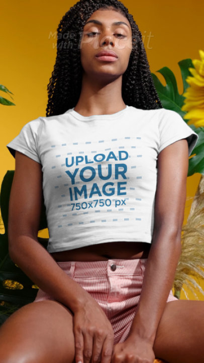 T-Shirt Video of a Serious Woman Posing by Palm Tree Leaves 3733v