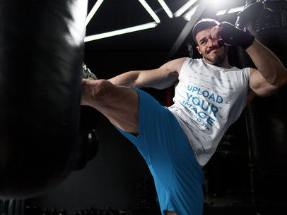 Mockup of a Man Kicking the Bag While Wearing Custom Workout Clothes a16800