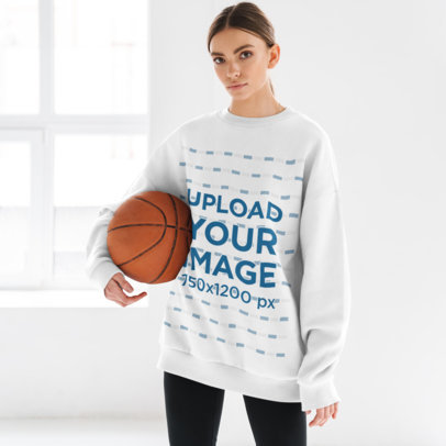 Oversize Sweatshirt Mockup of a Woman Holding a Basketball M10975-r-el2