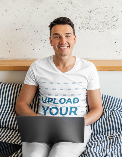 V-Neck Tee Mockup of a Happy Man on His Bed Using His Laptop m15515-r-el2