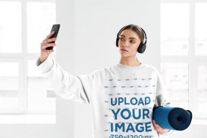 Round-Neck Sweatshirt Mockup of a Woman with Headphones Taking a Selfie M10971-r-el2