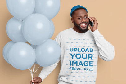 Sweatshirt Mockup of a Man Holding Colored Balloons While Talking on the Phone m3572-r-el2