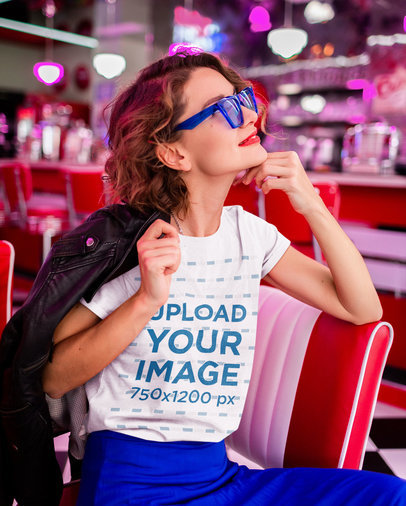 T-Shirt Mockup Featuring a Woman Wearing a Retro Outfit at a Diner m15503-r-el2