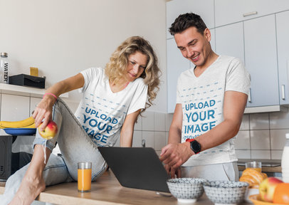V-Neck T-Shirt Mockup Featuring a Couple Using a Laptop in Their Kitchen m15513-r-el2