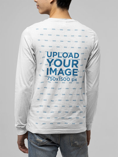 Back View Mockup of a Young Man Wearing a Customizable Long Sleeve Tee m13908