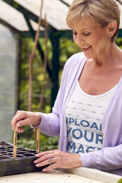 Scoop-Neck Tee Mockup of an Elderly Woman Doing Home Gardening m16419-r-el2
