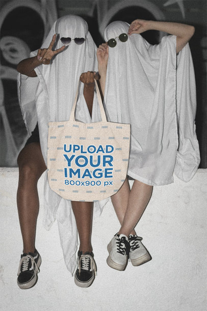 Tote Bag Mockup of Two Trick-or-Treaters in Cool Ghost Costumes m16721