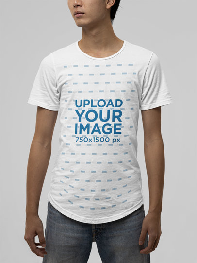 T-Shirt Mockup of a Young Man Wearing a Bella Canvas Garment in a Studio m13896