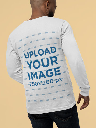 Back View Mockup Featuring a Man with a Bella Canvas Long Sleeve T-Shirt M13940