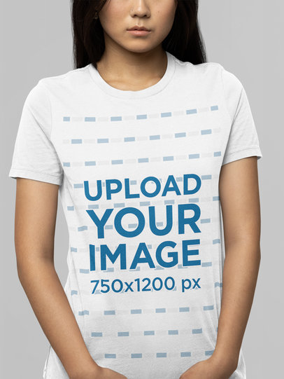 Mockup of a Woman Wearing a Bella Canvas T-Shirt In a Studio m14372