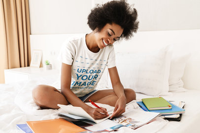 T-Shirt Mockup Featuring a Woman Doing Homework in Her Bedroom 45287-r-el2