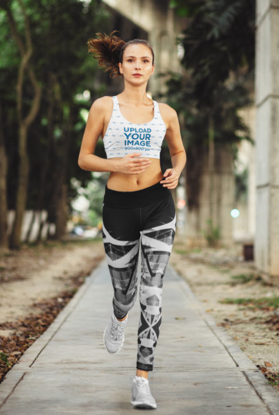 Sports Bra Mockup Featuring a Long-Haired Woman Jogging m9376-r-el2