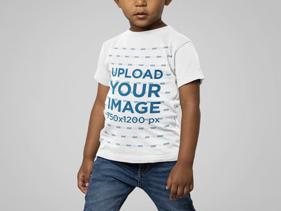 Bella Canvas Tee Mockup Featuring a Kid Standing in a Studio M14949
