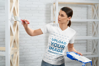 V-Neck Tee Mockup of a Woman Painting Some Furniture M16442-r-el2
