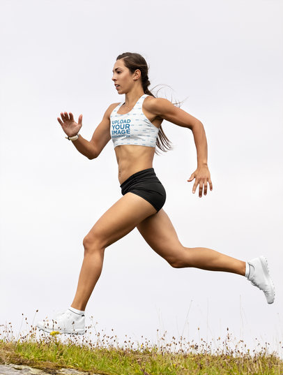Sports Bra Mockup of a Young Woman Running in the Outdoors m16679-r-el2