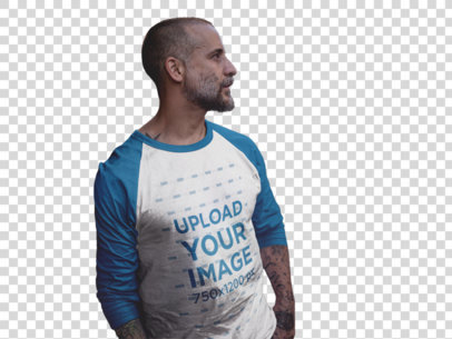 Transparent Raglan T-Shirt Mockup of a Tattooed Guy Leaning Against a Wall a12610