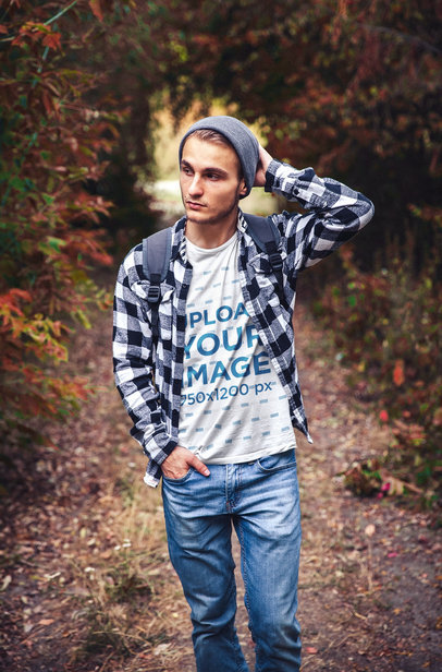 Transparent T-Shirt Mockup of a Man Surrounded by Nature in Autumn 42275-r-el2