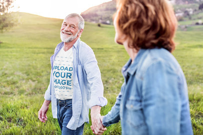 Transparent V-Neck T-Shirt Mockup of a Happy Senior Man Holding Hands with His Wife 39100-r-el2
