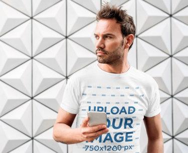 Transparent T-Shirt Mockup of a Bearded Man Holding a Phone 35260-r-el2