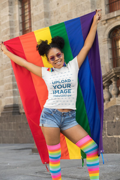 Transparent T-Shirt Mockup of a Woman Proudly Holding a Rainbow Flag 32985
