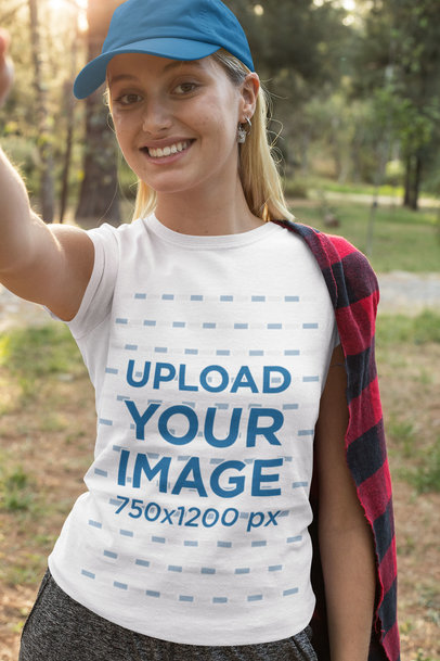 Transparent T-Shirt Mockup Featuring a Woman Taking a Selfie in the Forest 32245