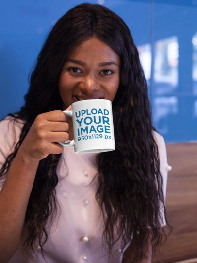 Mockup of a Woman Holding a Coffee Mug While Indoors 17339
