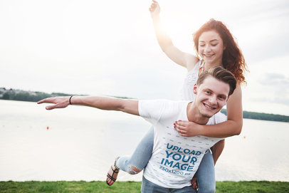 Transparent T-Shirt Mockup of a Playful Couple Having Fun by a Lake 46402-r-el2