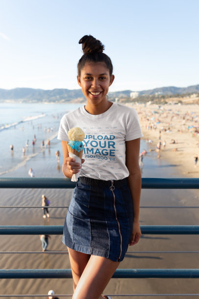 Transparent T-Shirt Mockup of a Happy Girl with an Ice Cream at a Beach Pier 18213