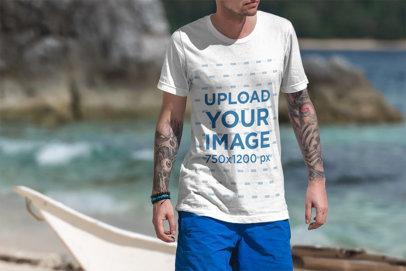 Transparent T-Shirt Mockup of a Tattooed Man Walking on the Beach 3333-el1